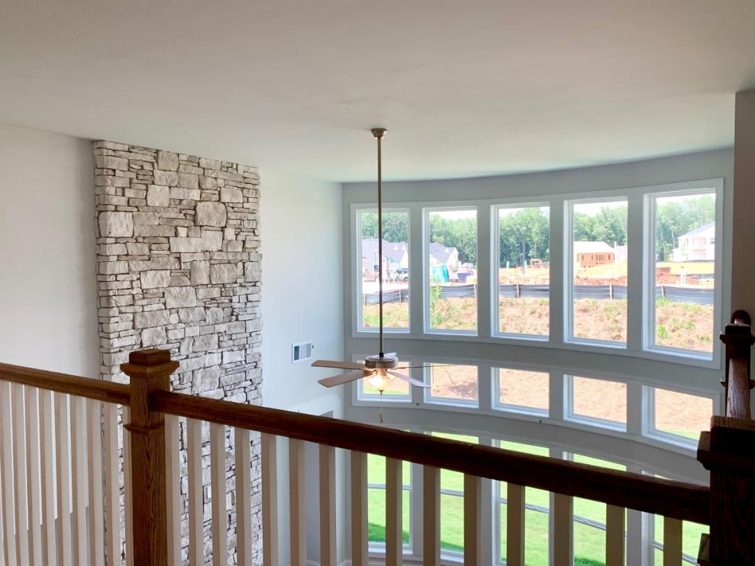 """Dramatic interior views of the two story great room with the """"wall of windows"""""""