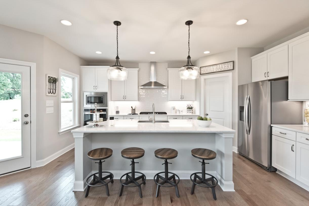 A welcoming entrance, the oversized kitchen island provides a centerpiece for entertaining