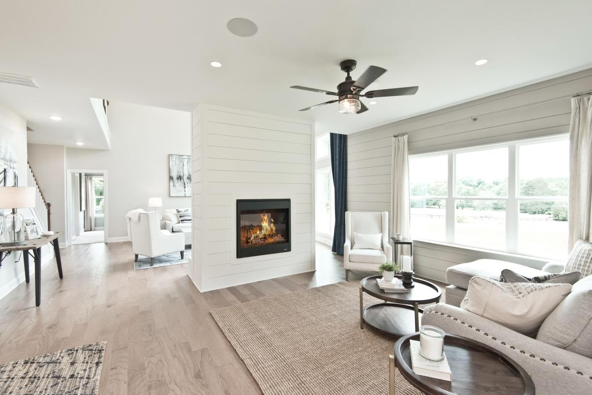 The open-concept kitchen, great room, keeping room, and dining room are ideal for entertaining