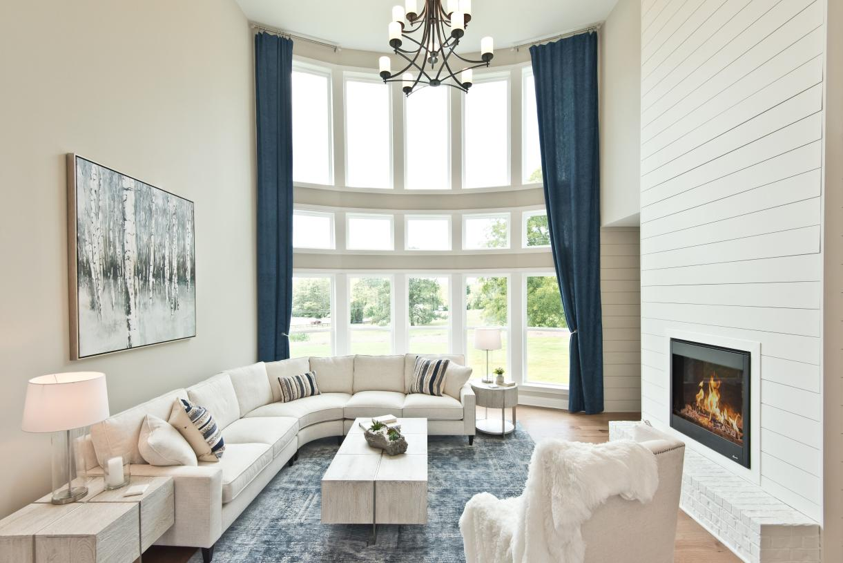 """Popular two story great room with Toll's signature """"wall of windows"""" gives this home an abundance of natural light"""
