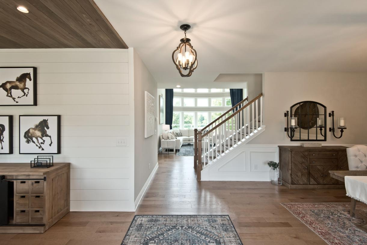 A welcoming entrance offers views of hardwood floors