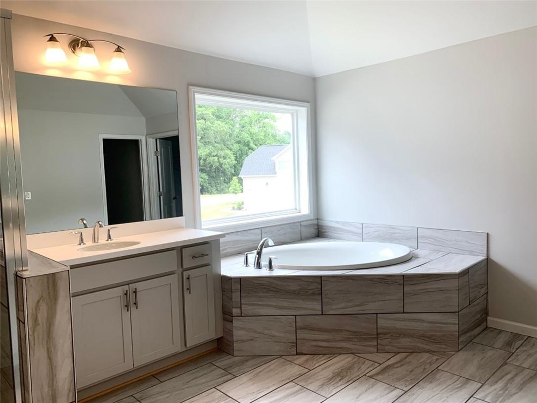 Large primary bath with soaking tub and spacious shower