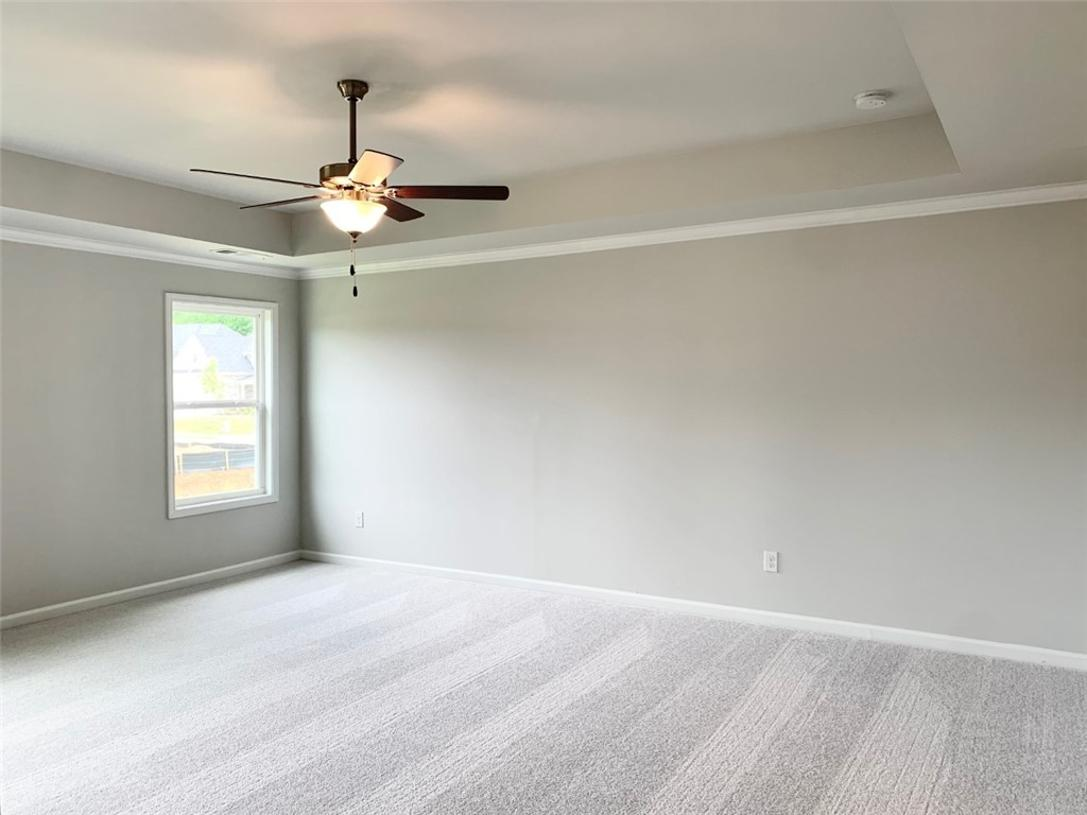Spacious primary bedroom with trey ceiling