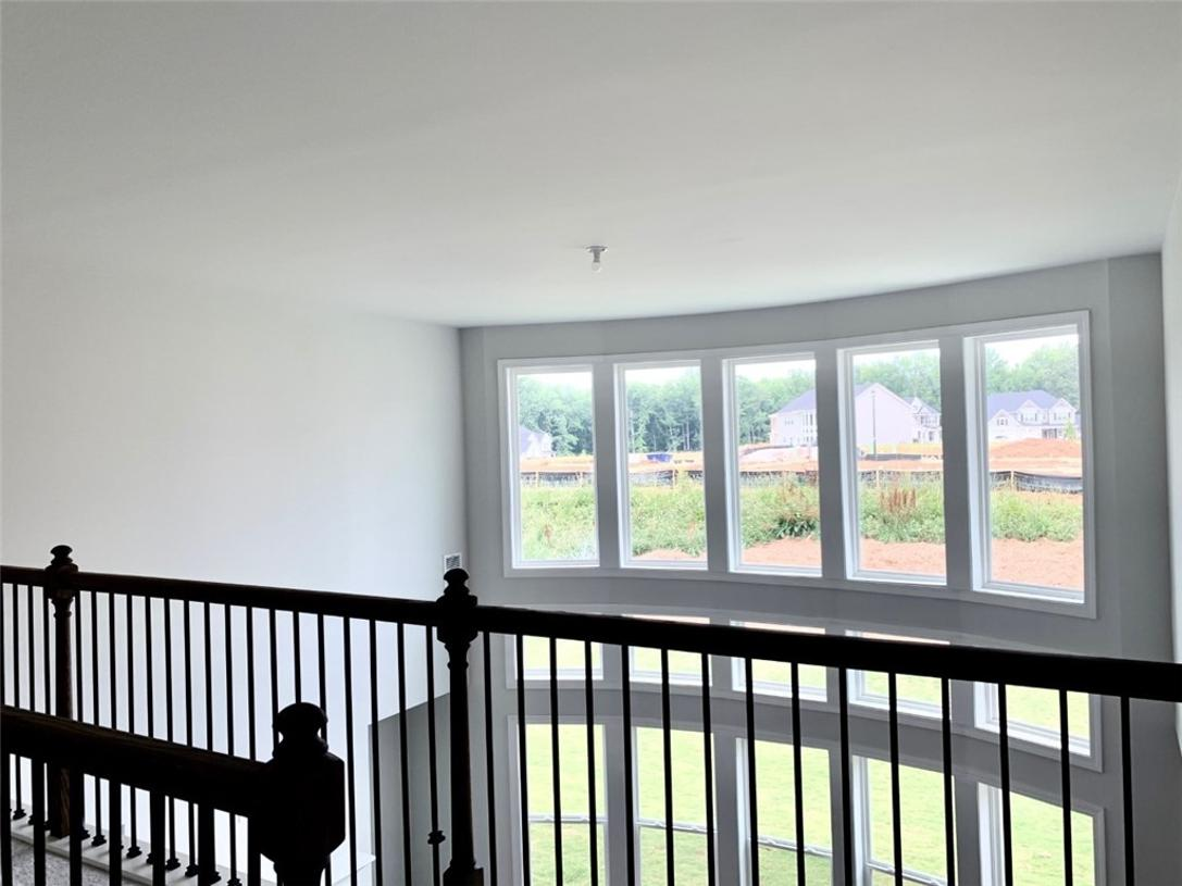 Stunning view to the bowed two story family room