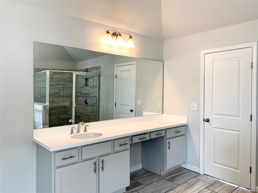Primary bath includes dual vanities