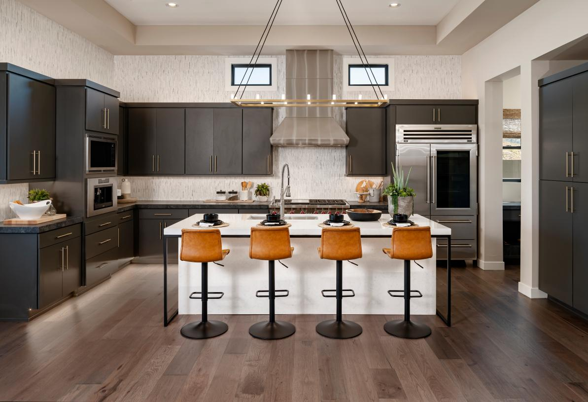 Well-appointed kitchen with large center island, and premium stainless steel appliances