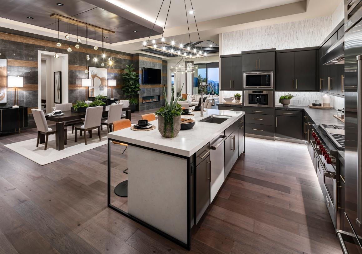 Gourmet kitchen overlooks the dining room and great room