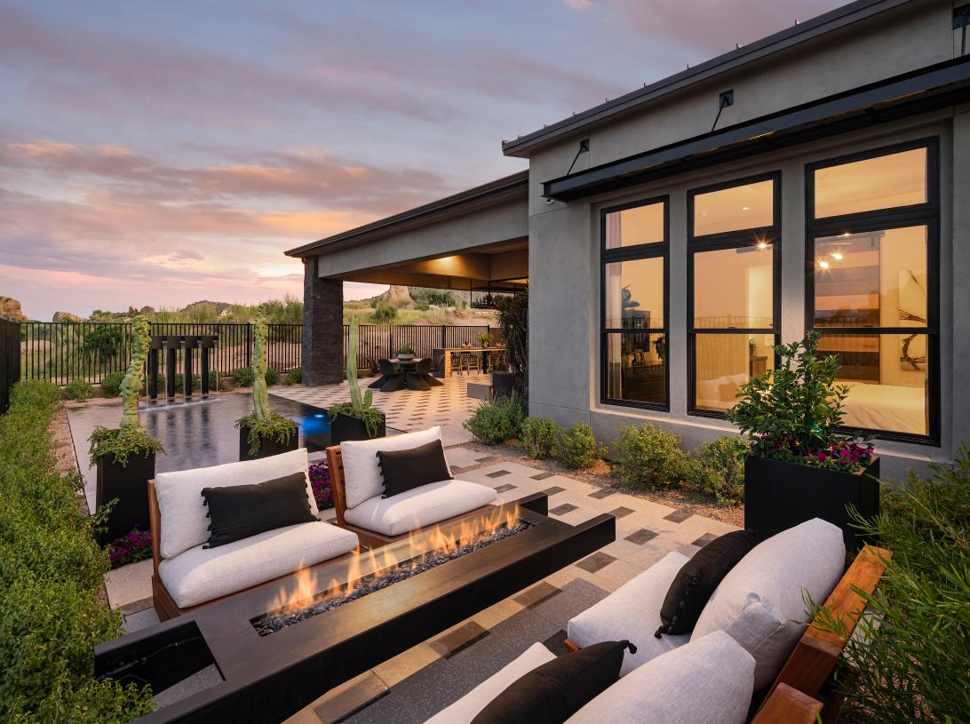 Outdoor living area with fire feature and Sonoran Desert views