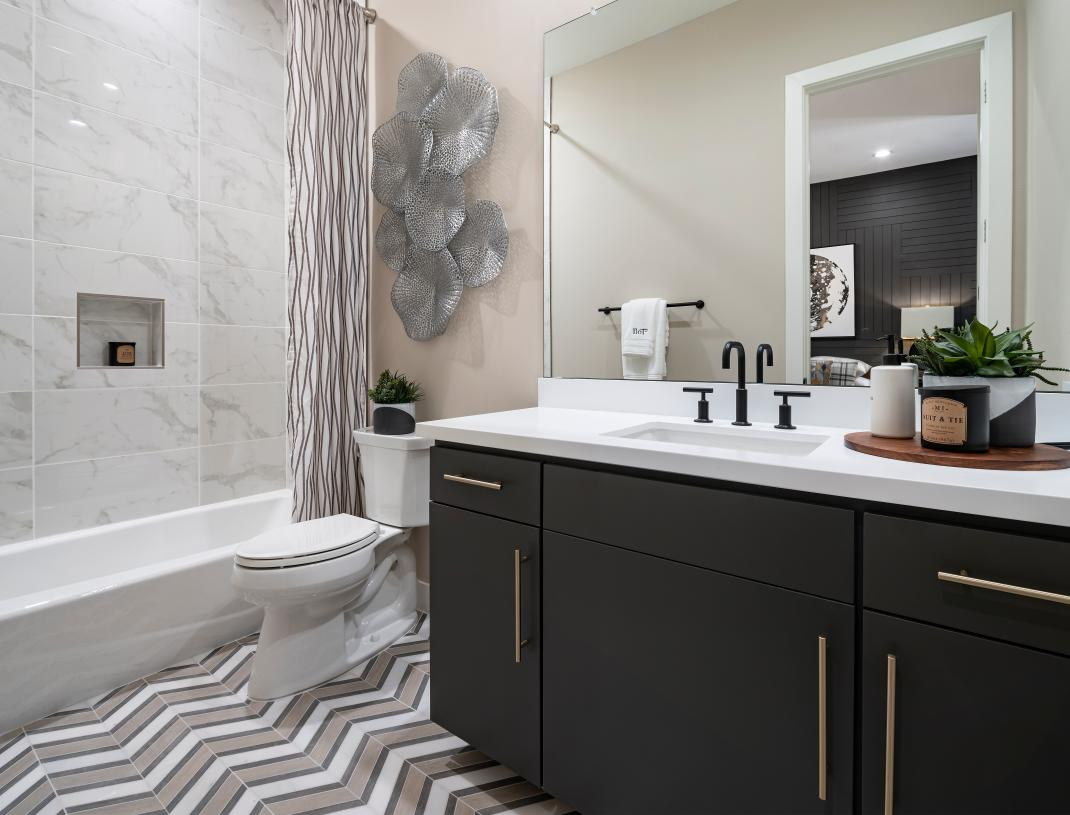 Secondary bath with beautiful marble shower surround