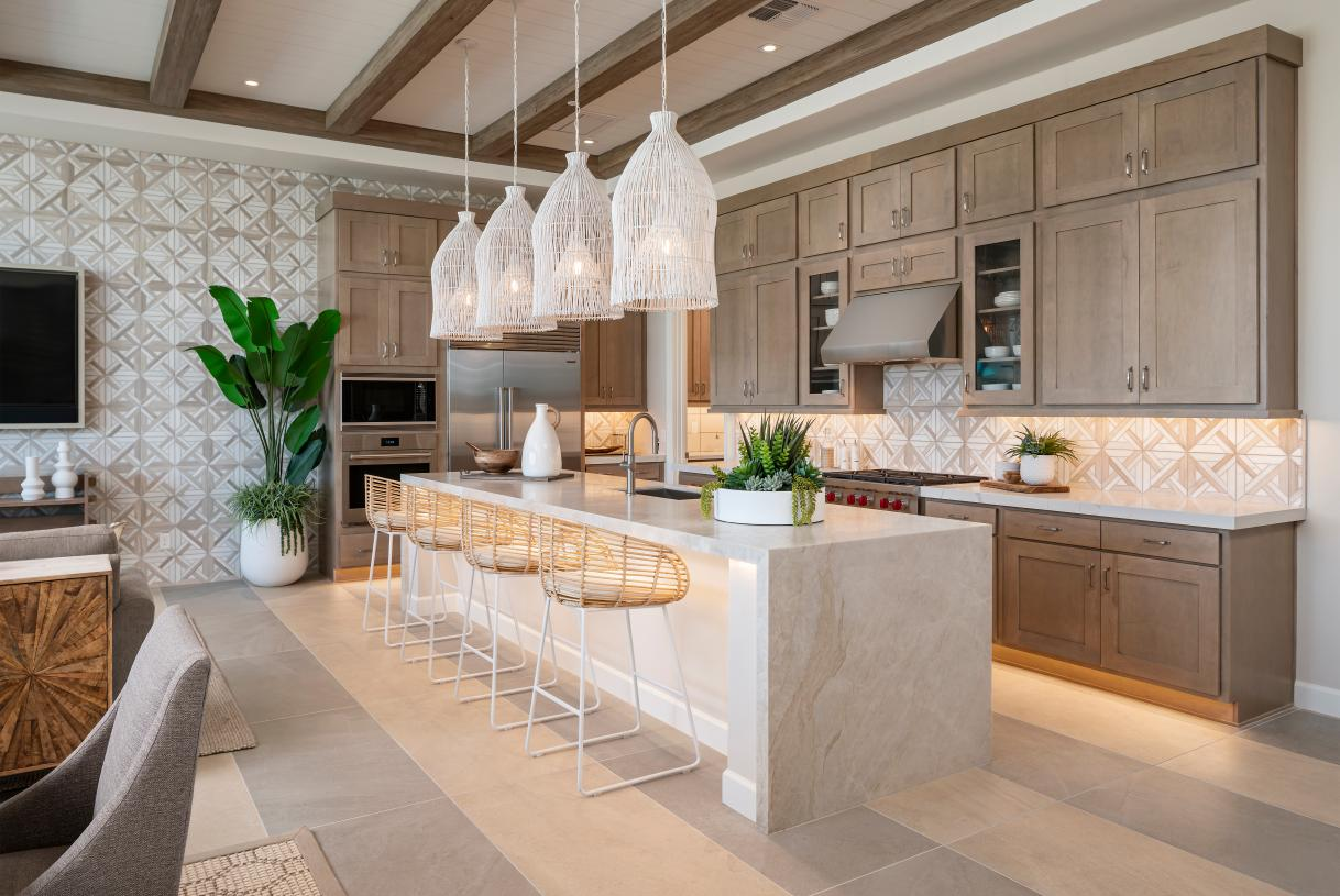 Gourmet kitchen with large center island and stainless steel Wolf appliances