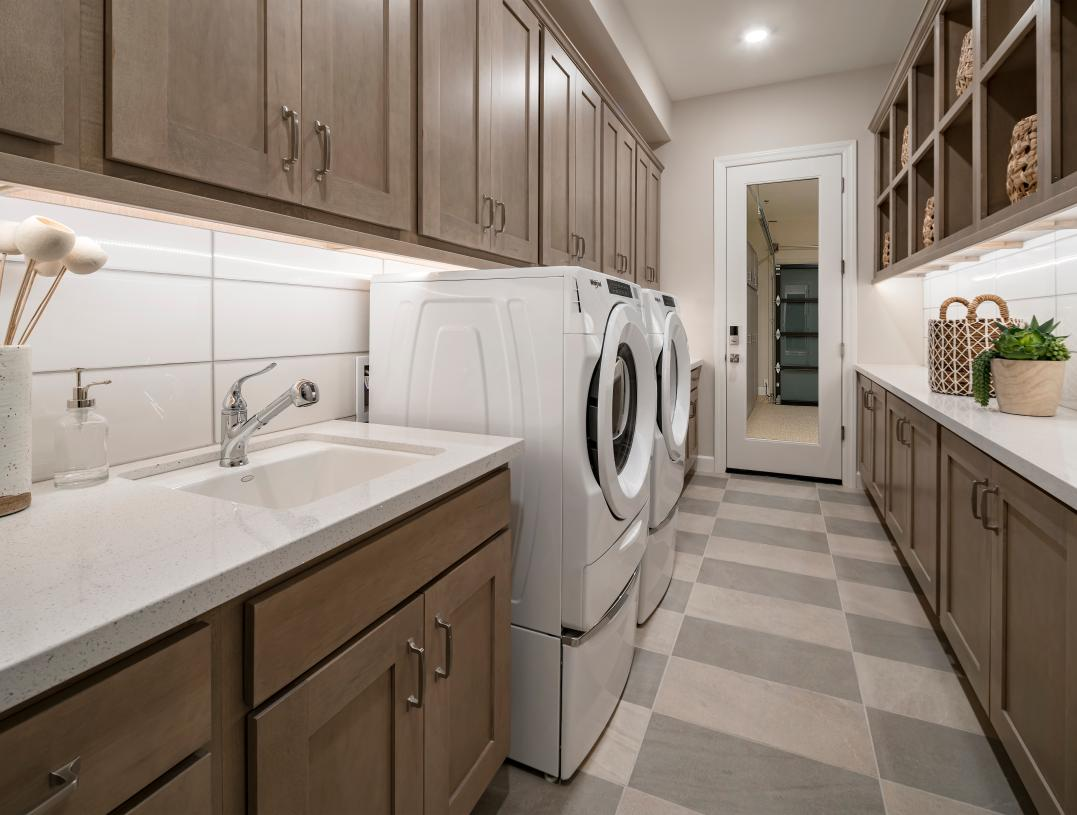Centrally located laundry room with ample storage