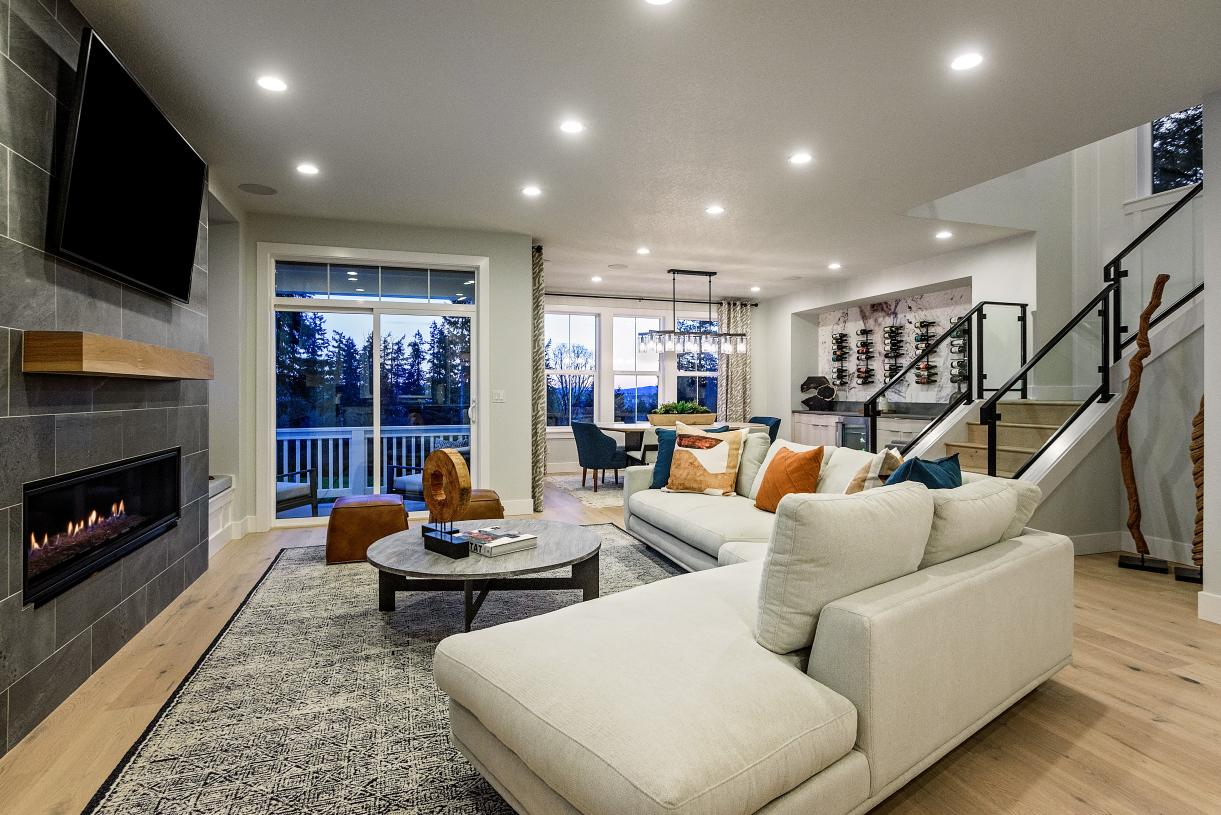 The Silverton home design features open concept living with a covered deck off of the great room