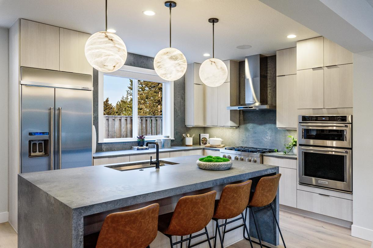 The large kitchen island of the Silverton home offers seating for four