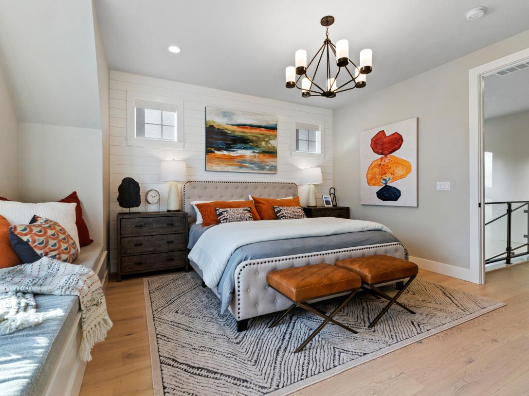 Primary bedroom suite with cozy built-in bench