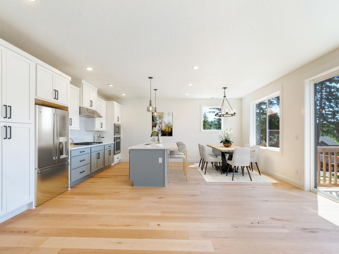 Kitchen and dining with rear yard access through sliding glass doors