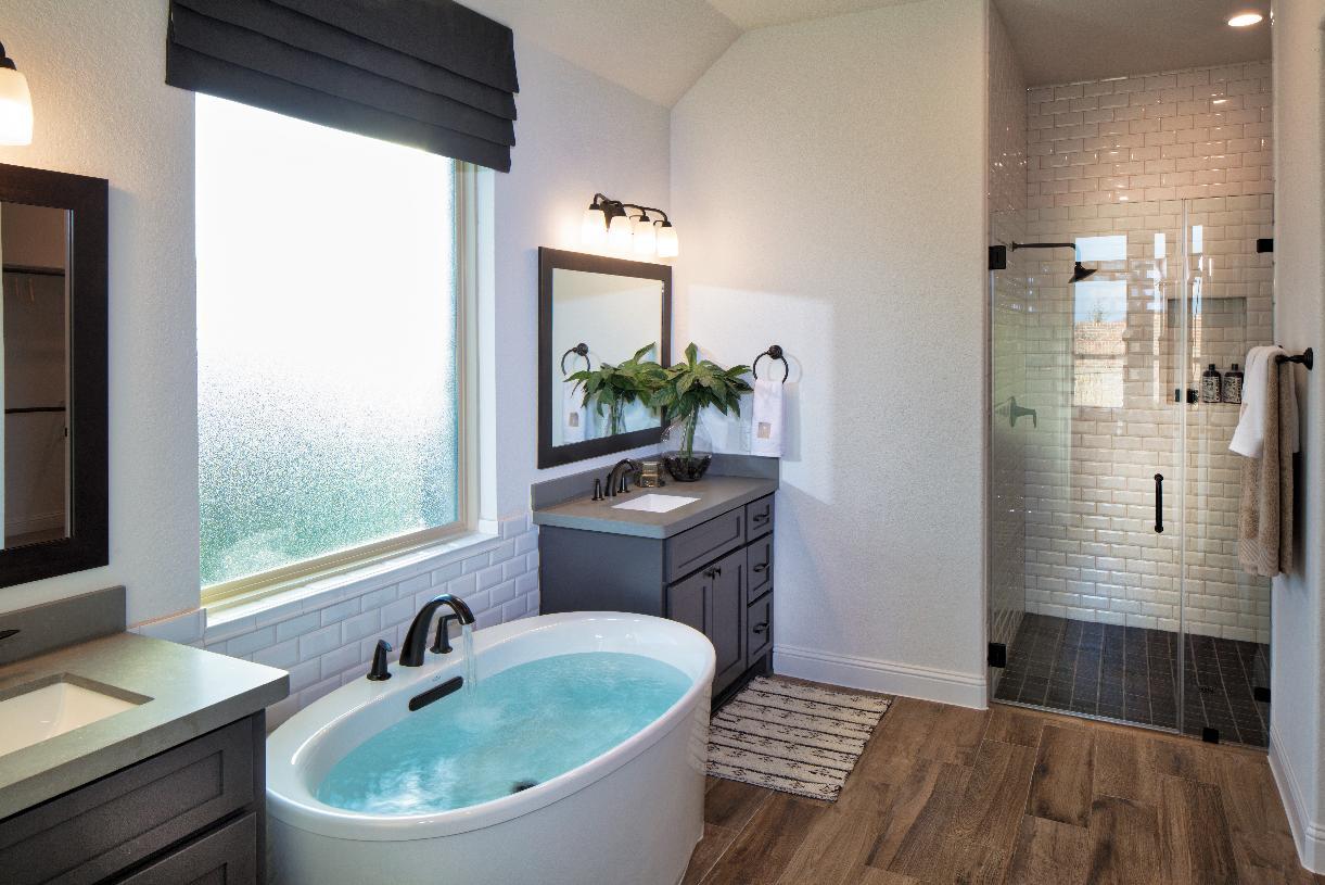 Loralai's resort-style primary bath with dual vanities