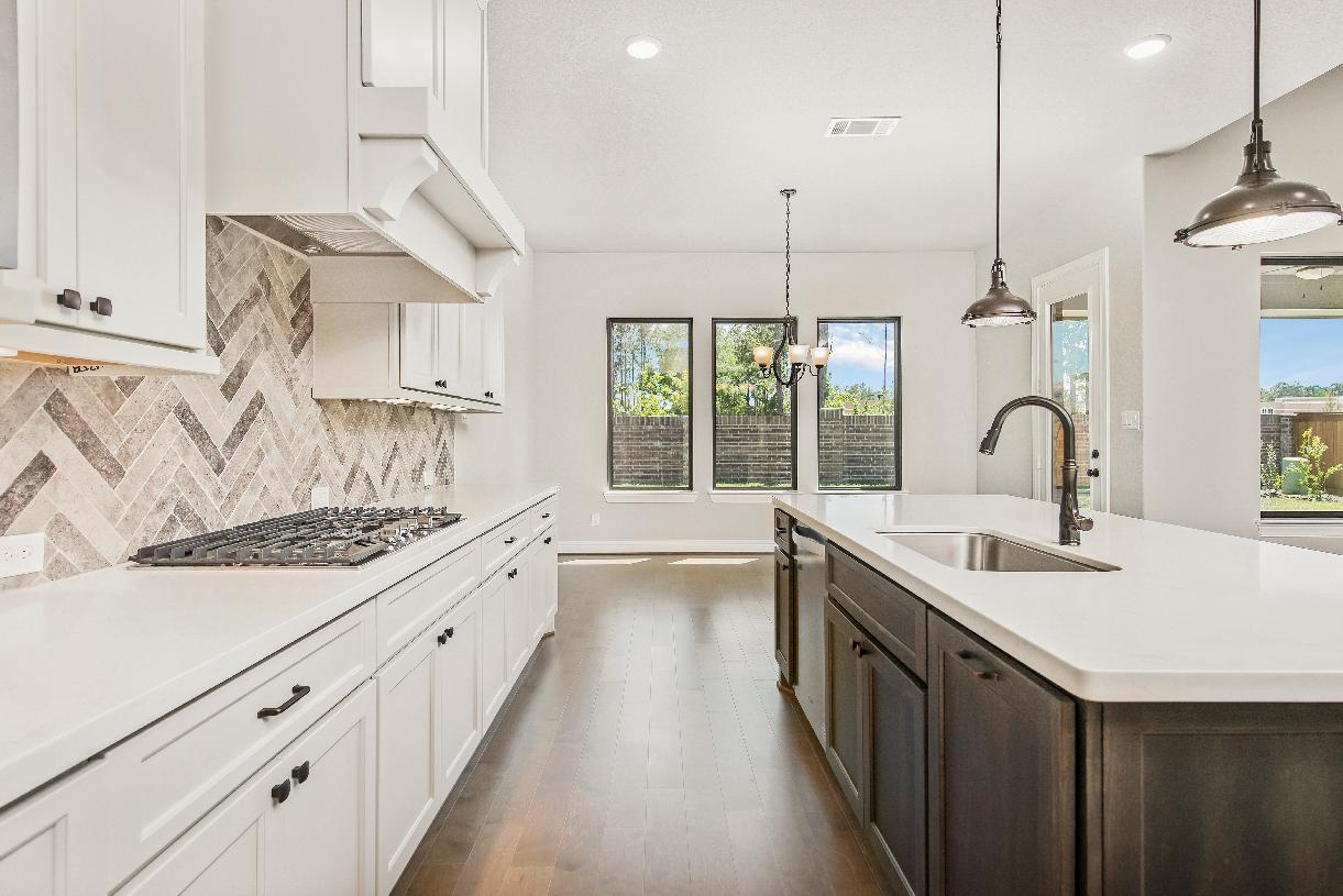 Westbury's gourmet kitchen with extra counter space for entertaining