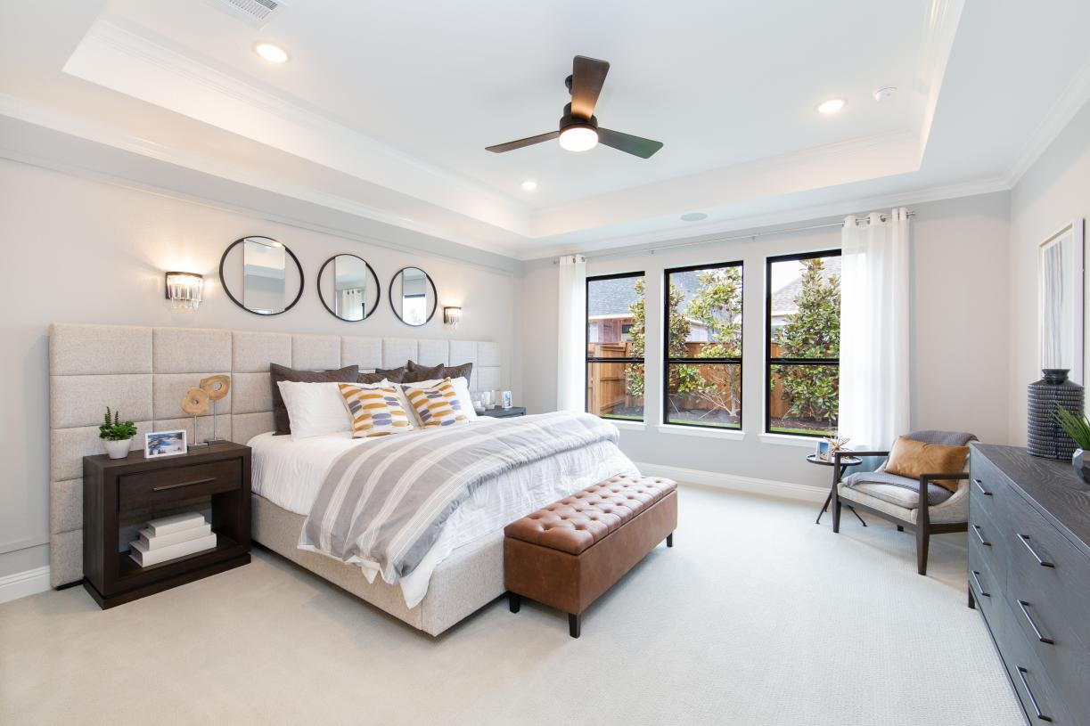 Primary bedroom suite is enhanced by a tray ceiling
