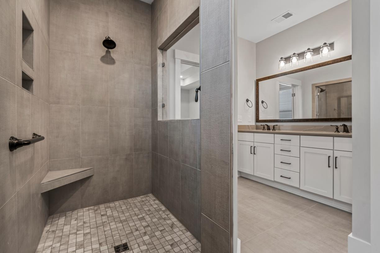 Lavish primary bathrooms with cave shower options