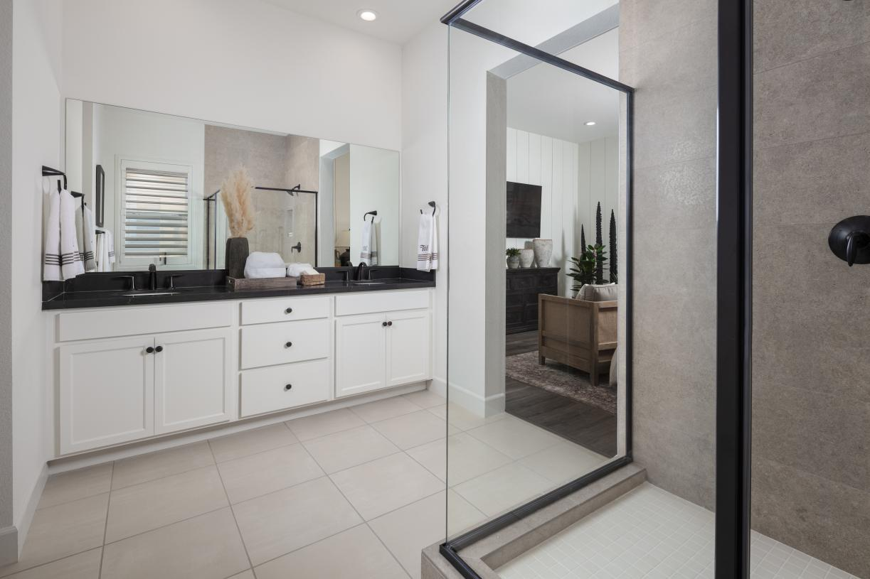 Primary bath that offers dual vanity and walk in closet