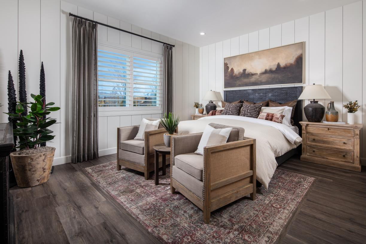 A spacious primary bedroom suite
