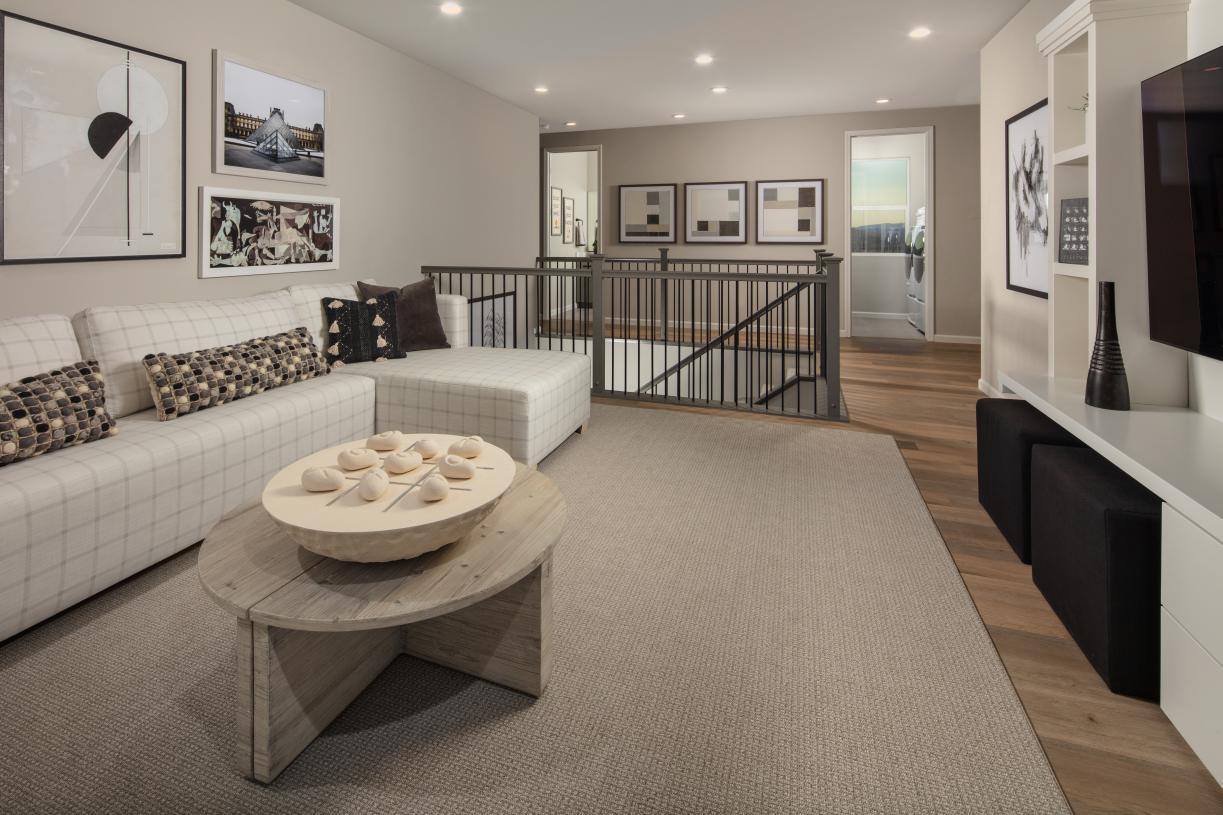 Second level loft offers flexible living space
