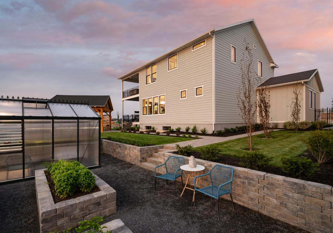 Gorgeous backyard with a seating area, multiple covered decks, outdoor kitchen, and more