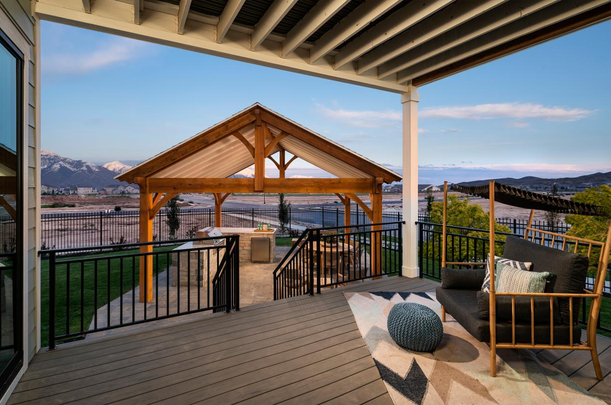 Rear covered deck for outdoor living and entertaining