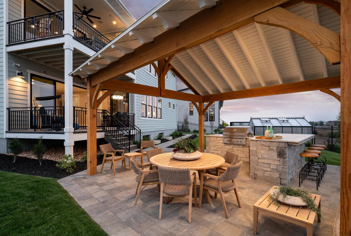 Beautiful backyard with an outdoor kitchen and dining area