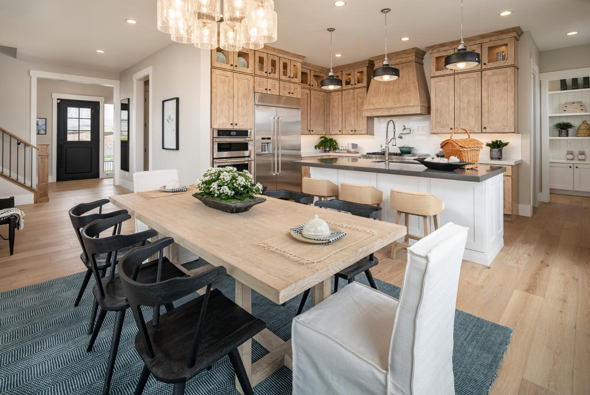 Stunning kitchen design with large center island and casual dining area adjacent