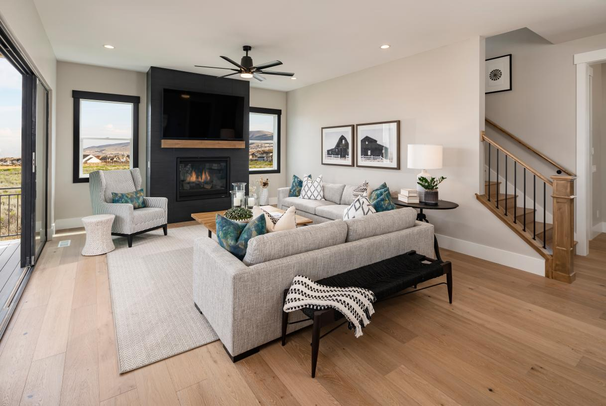 Spacious great room with cozy fireplace and easy access to outdoor living