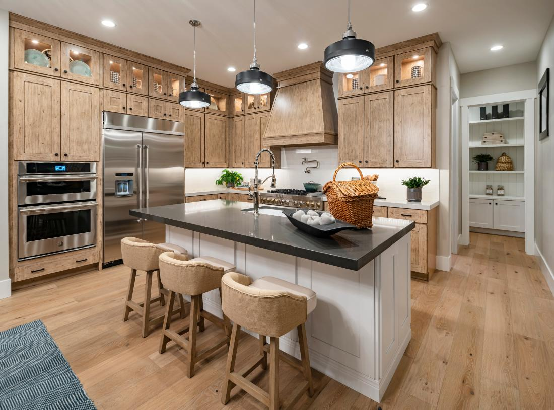 Gorgeous kitchen with large center island for casual dining and ample cabinet space