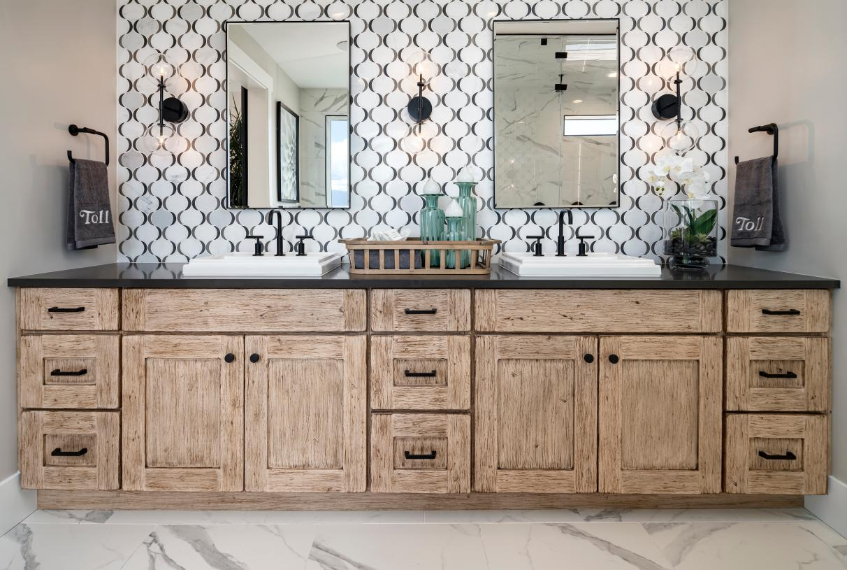 Beautiful primary bathroom with dual-sink vanity, ample countertop and cabinet space