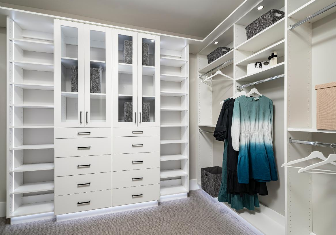 Huge walk-in primary closet with ample storage space