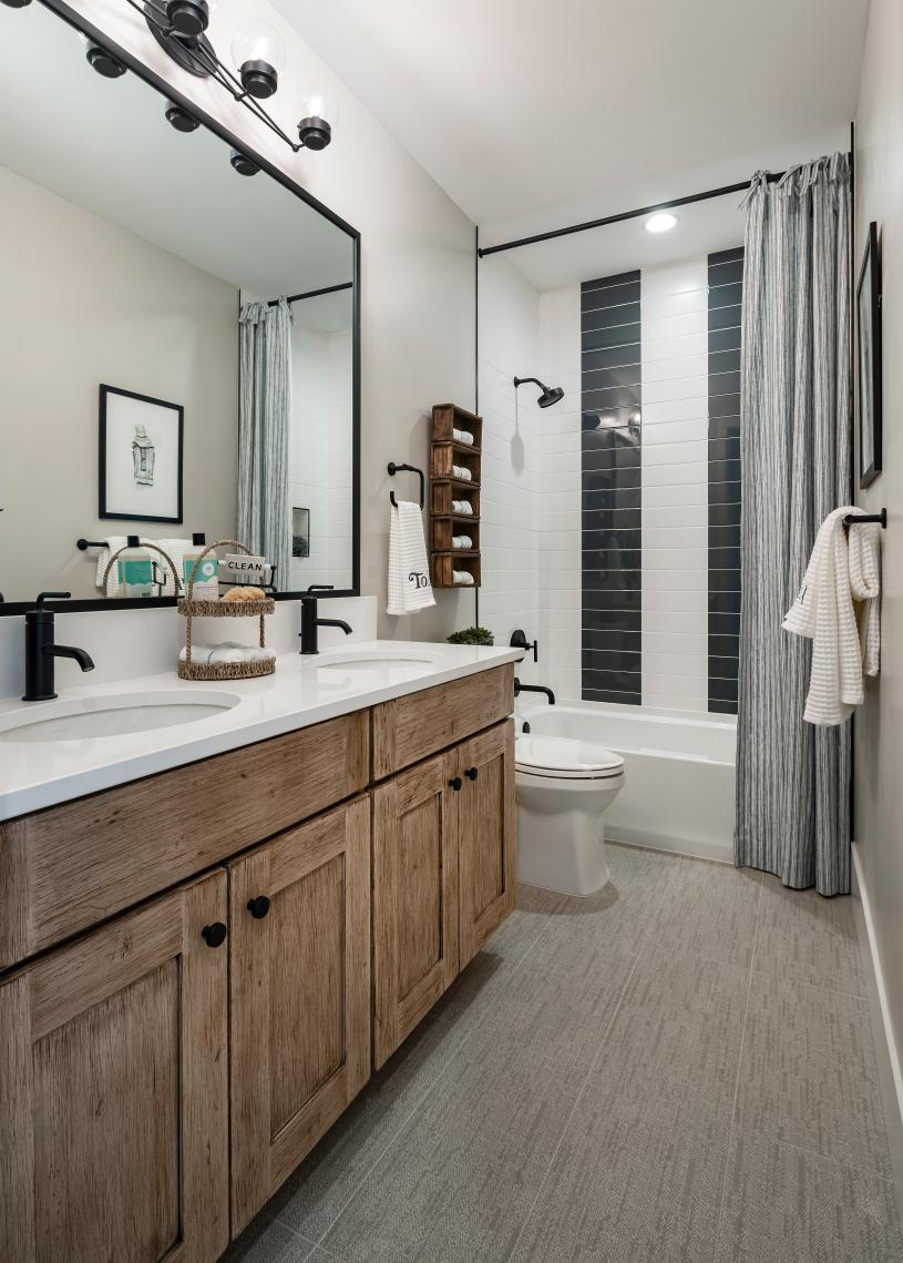 Shared secondary bathroom with beautiful tile and ample countertop space