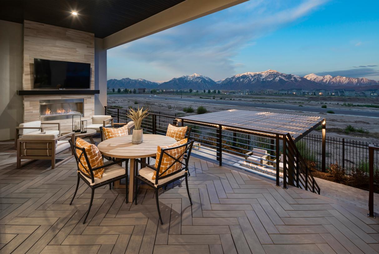Upper covered deck for outdoor living, with a fireplace and views of the beautiful mountains