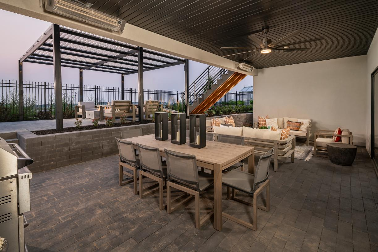 Walk-out basement covered patio for outdoor dining, living, and entertaining