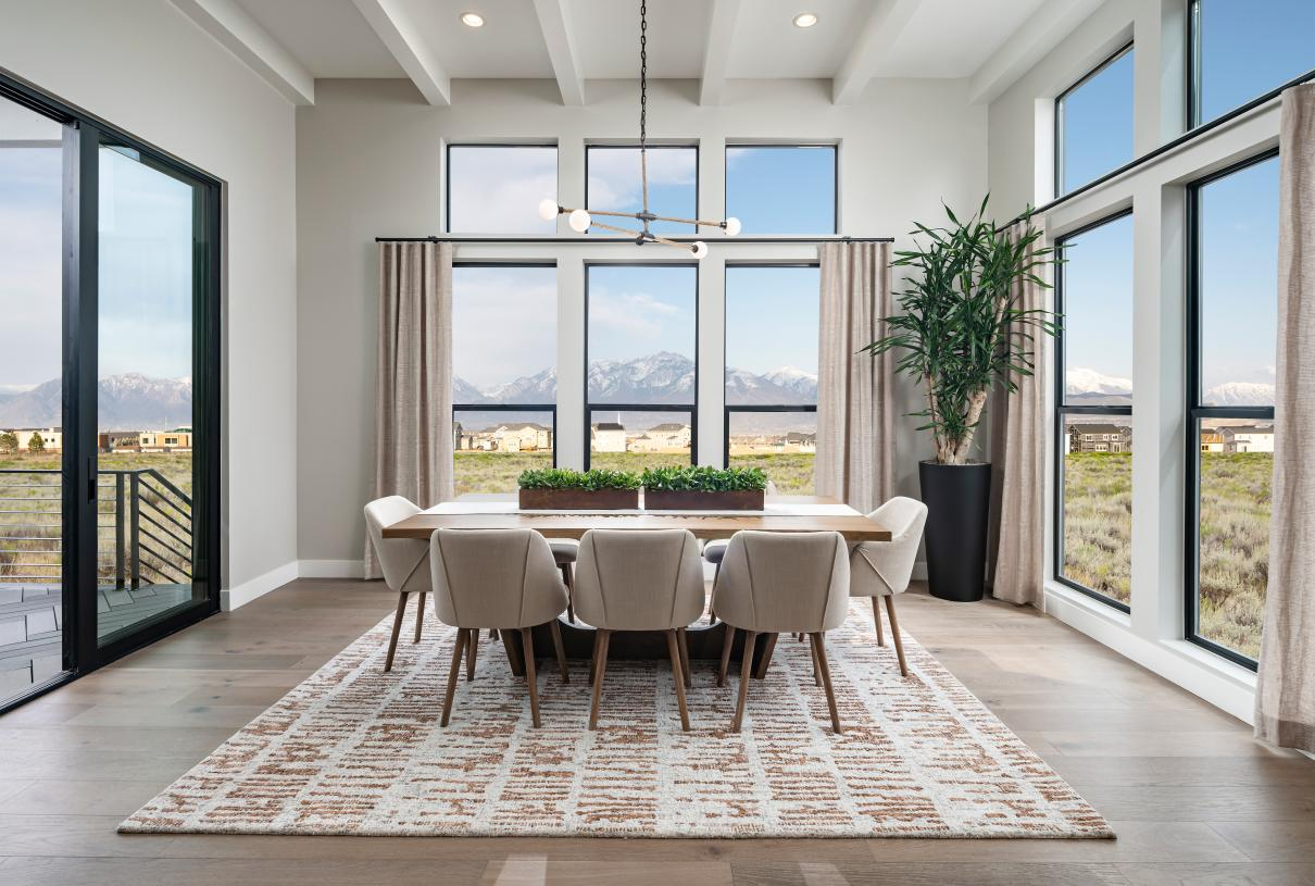 Beautiful dining area with ample natural light and access to the covered patio