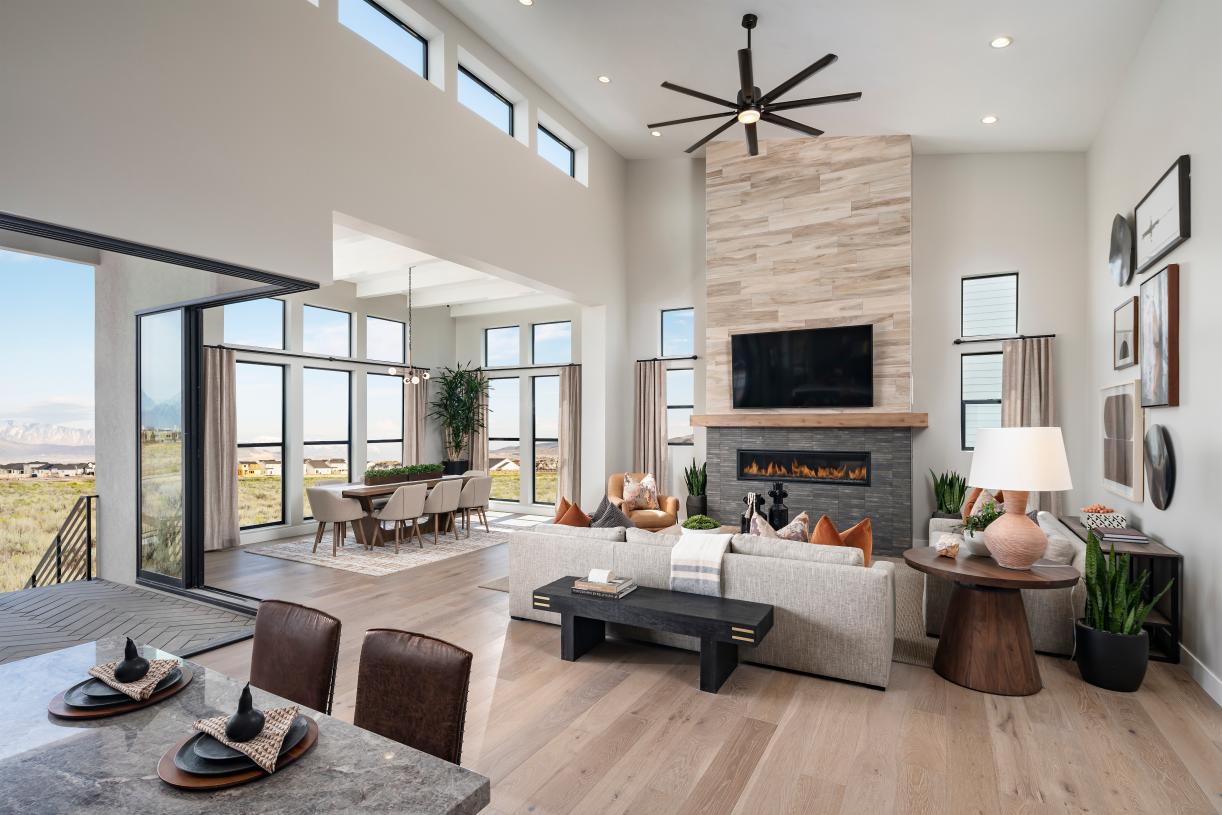 Spacious great room with soaring tall ceilings and beautiful cozy fireplace