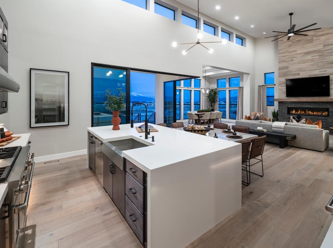 Open-concept floor plan with large center island and views of the great room beyond
