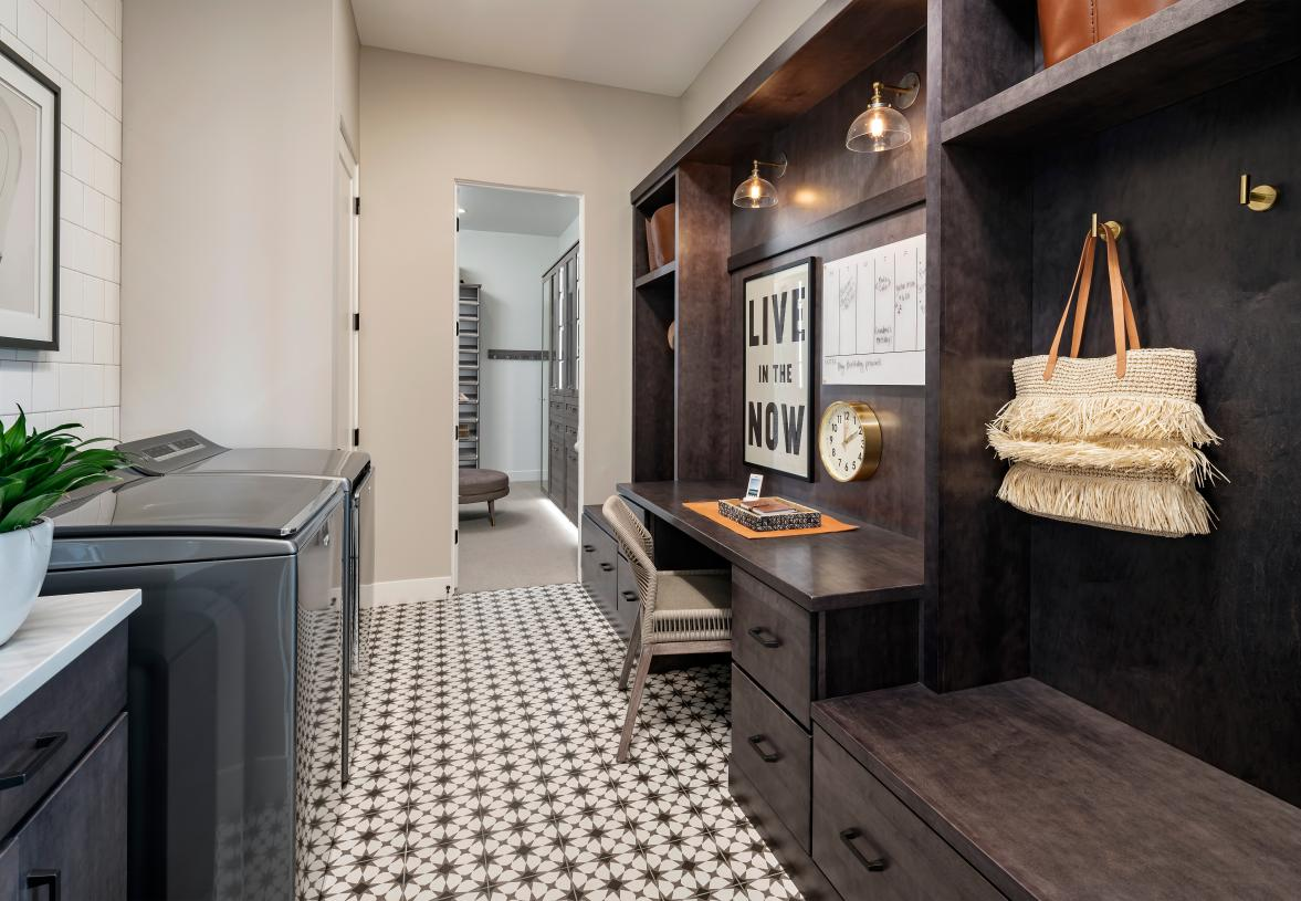 Versatile additional laundry room and storage located off the primary suite closet