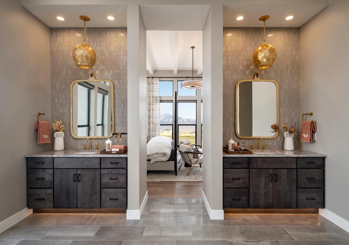 Lavish primary bathroom with dual-split vanities