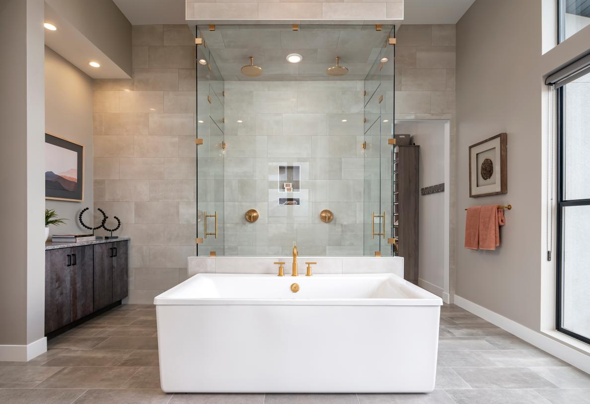 Luxurious primary bathroom with large walk-in shower and freestanding soaking tub