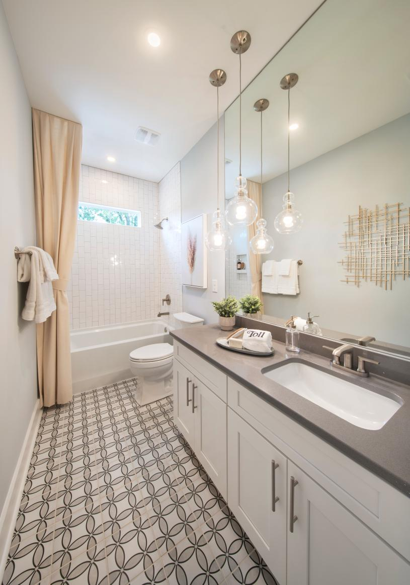 Large secondary bathroom with ample countertop and cabinet space