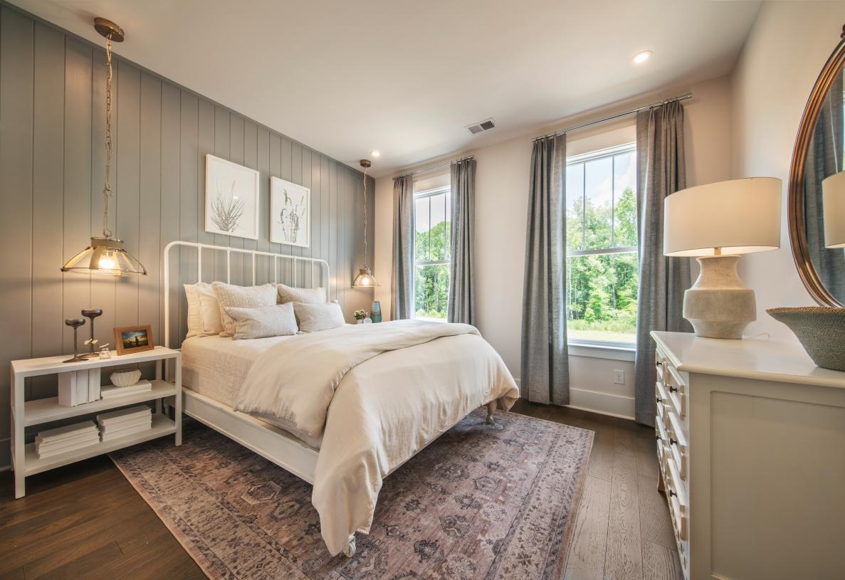 Spacious secondary bedroom with ample natural light and closet space