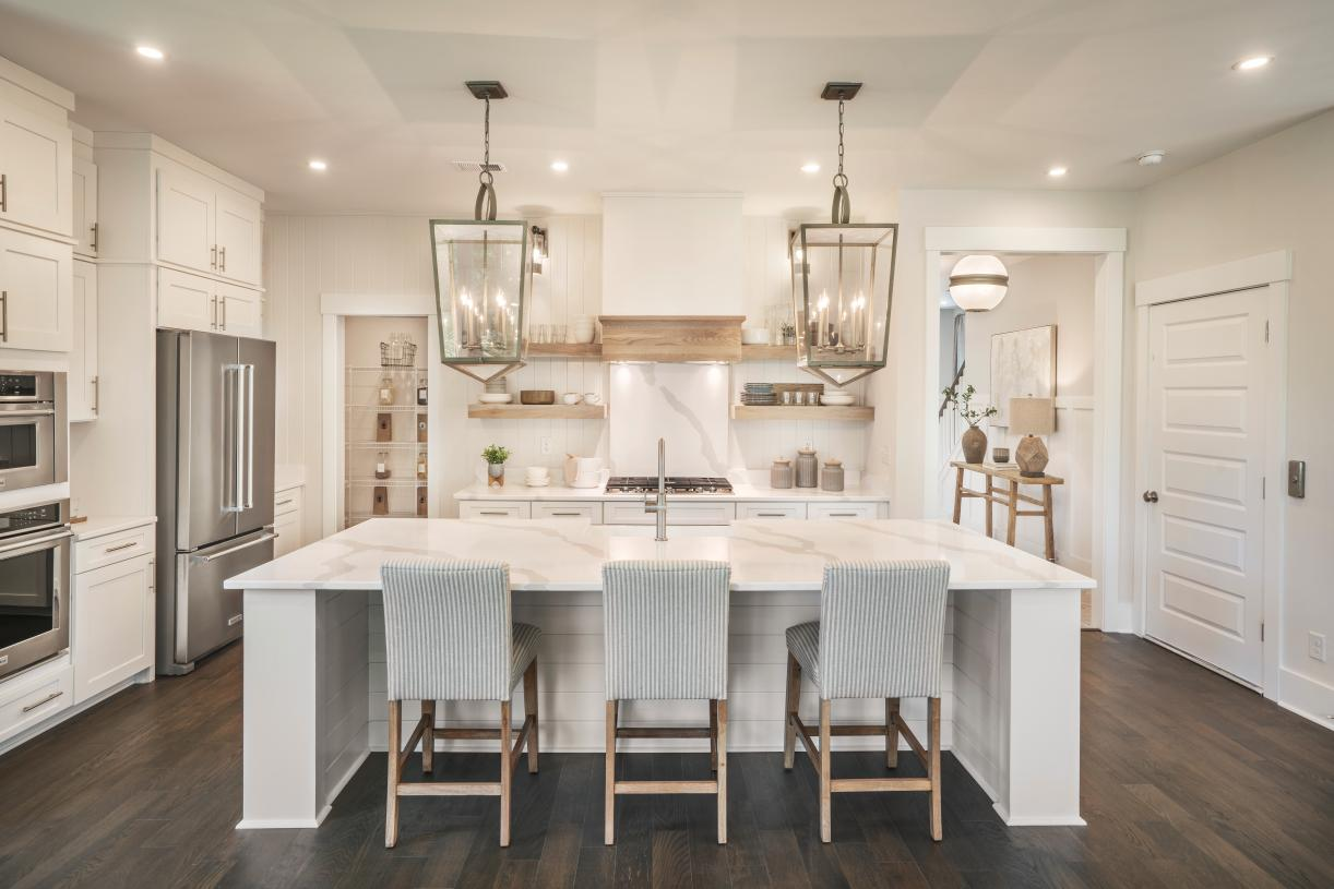 Gorgeous kitchen with ample countertop and cabinet space, and walk-in pantry
