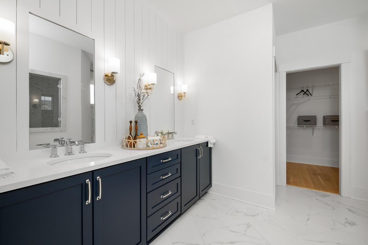 Lavish primary bathrooms with a large walk-in closet