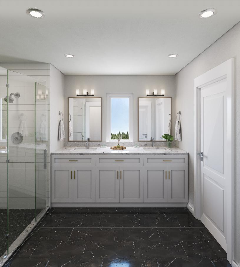 Natural light through the window over the dual-sink vanity brightens the primary bathroom