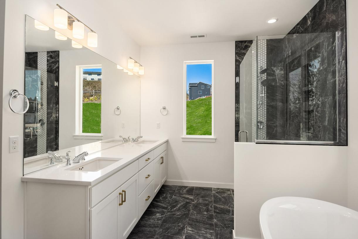 Representative photo - Primary bath offers a dual-sink vanity and large walk-in shower
