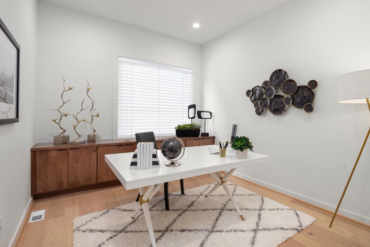 Secondary bedroom on the main floor is perfect for a home office